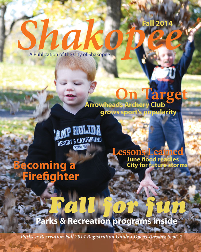 Kids playing in leaves on magazine