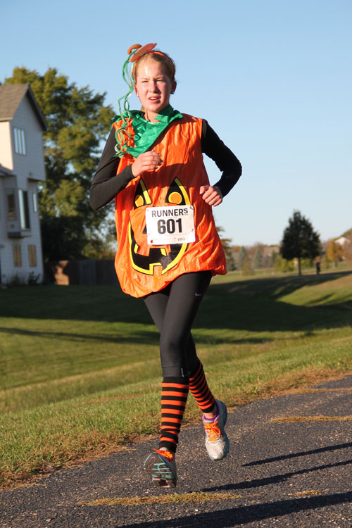 Runner dressed as a pumpkin
