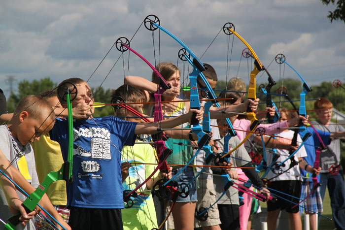 Kids shooting bows and arrows