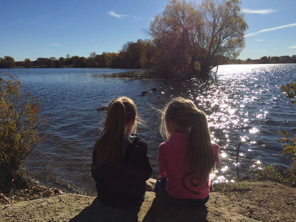 Two girls looking at water