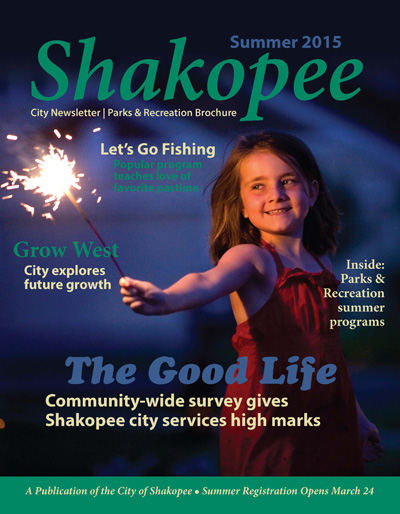 Little girl with sparkler on cover of magazine