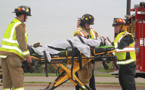 Fire wheels away victim on stretcher