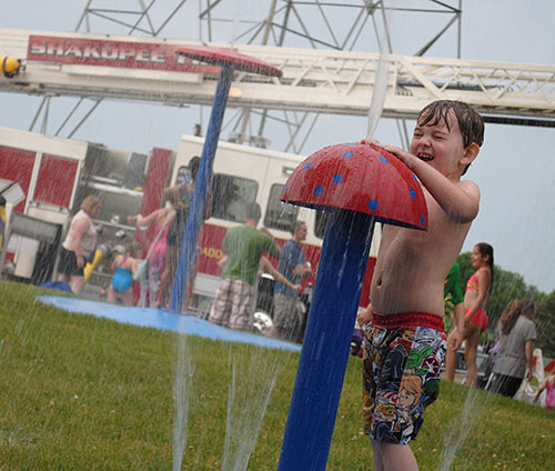 Little boy playing at splash pad