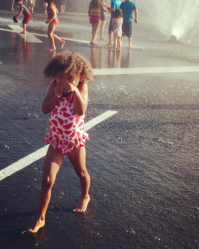 Little girl running in splash
