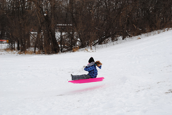 Girl flying on sled