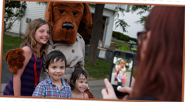 Mom taking photos of kids with McGruff
