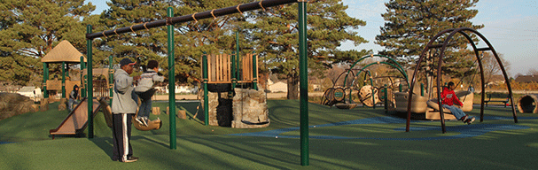 Families at inclusive playground