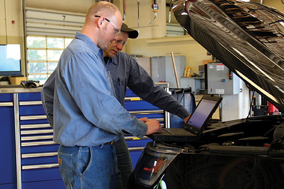 Mechanics looking at computer