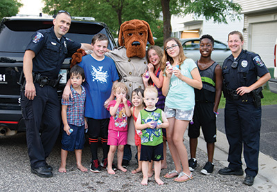 Kids with officers and McGruff