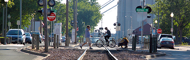 People crossing train tracks
