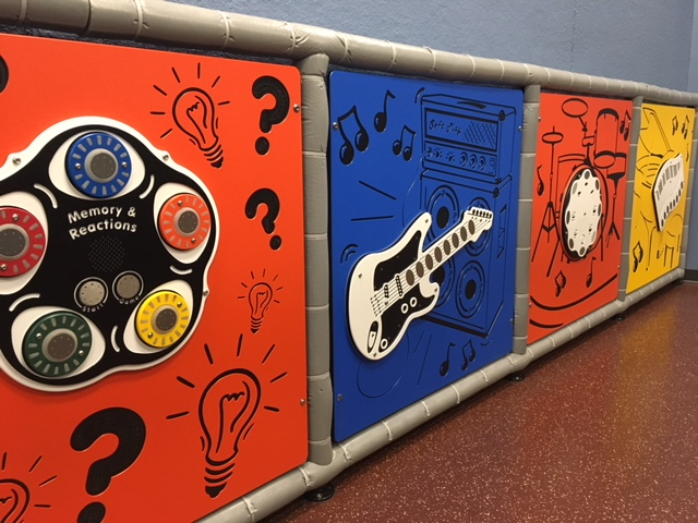 Musical instruments on playground wall
