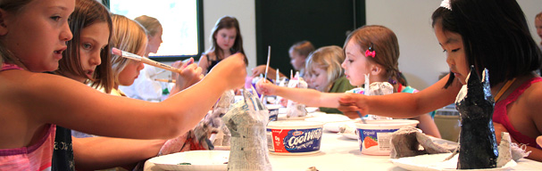 Girls painting at art camp