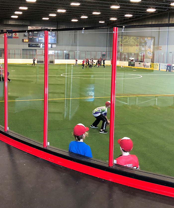 Kids practice baseball skills on the turf inside rink 2