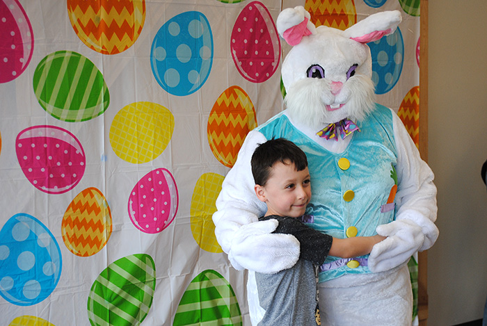 Boy hugging Easter bunny