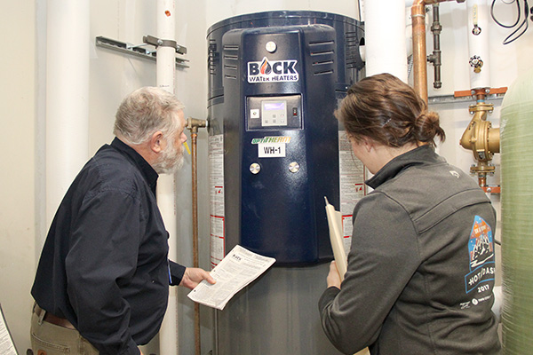 Inspectors looking at Water Heater
