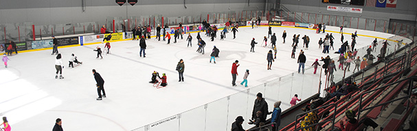 People skating around rink during open public skating