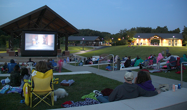 People watching movie at dusk at Huber Park