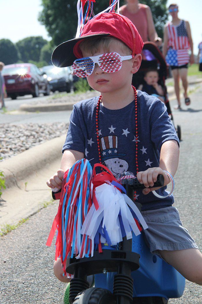 Boy dressed in red, white and blue