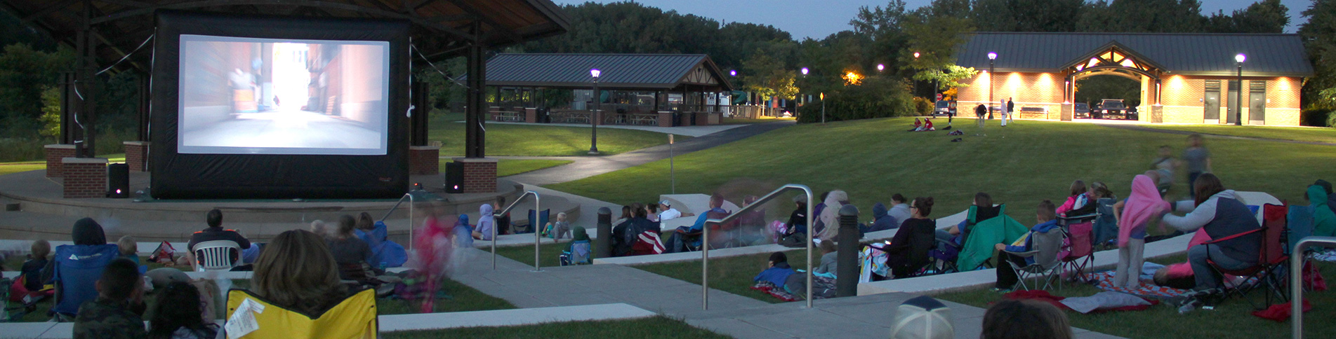 Crowds watch a movie at Huber Park
