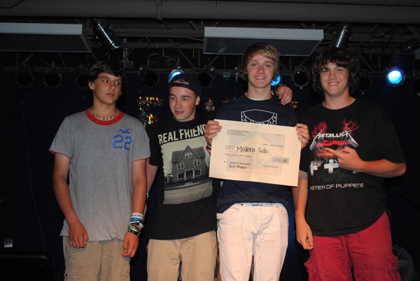 Band members with prize