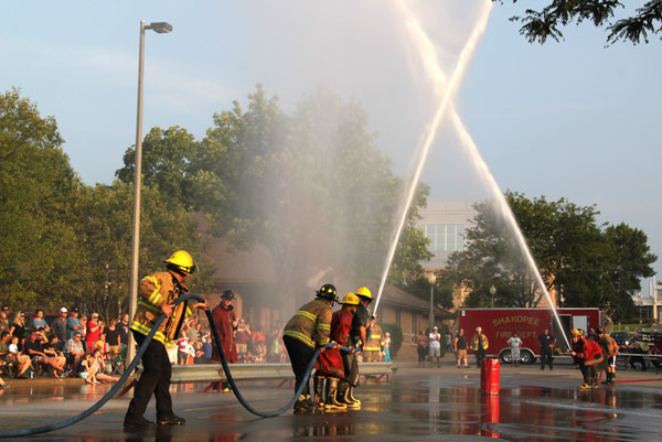 Firefighters spraying water in air