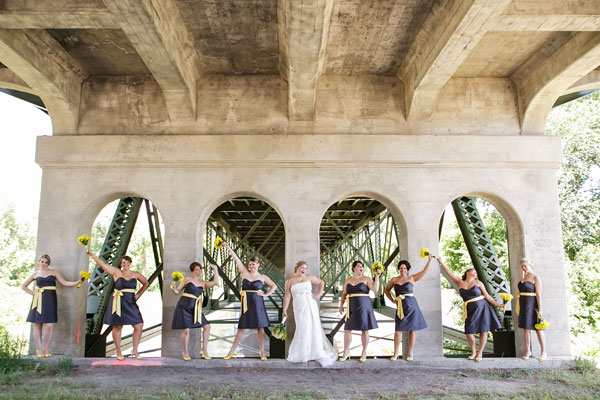 A wedding party dressed up under Holmes Street bridge