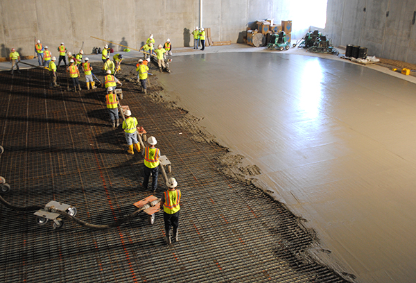 People pouring concrete