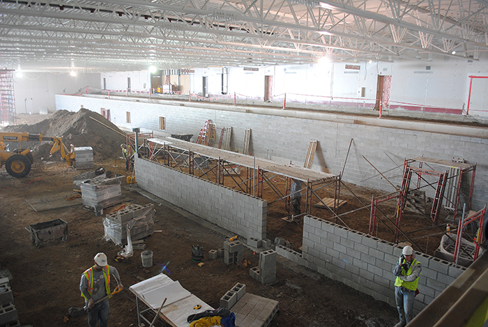 Crews adding walls in former ice arena space
