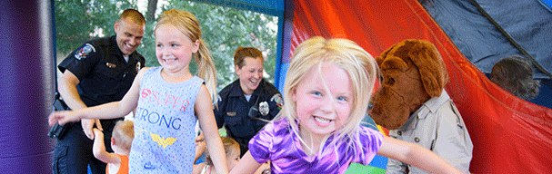 Kids and officers in bouncy house
