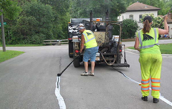 Crews seal street cracks
