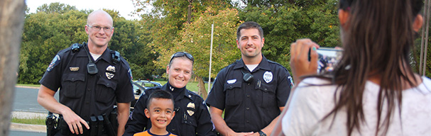 Officers posing for photo with child