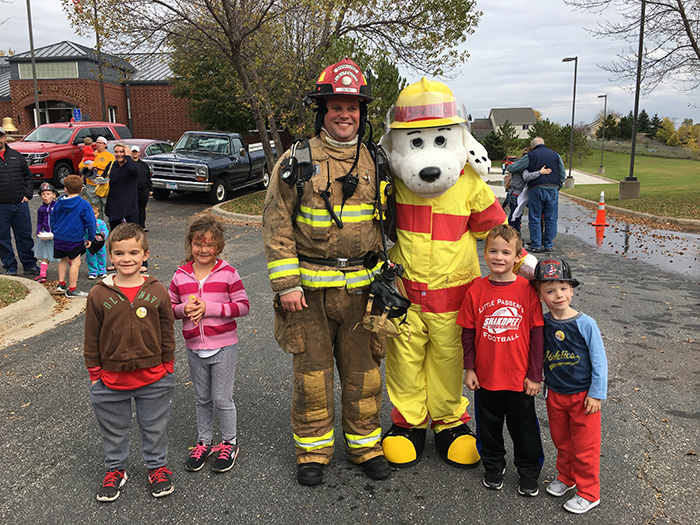 Firefighter with Sparky and kids