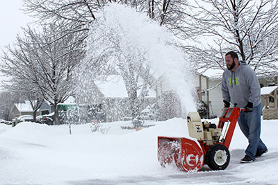 Man snowblowing
