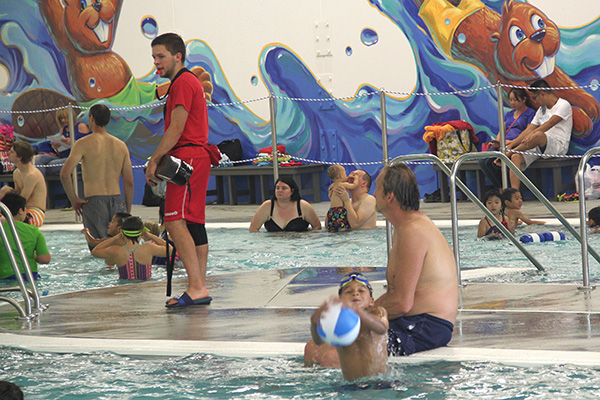 Lifeguard and families at pool