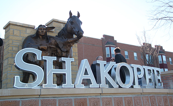 Chief Sakpe behind new SHAKOPEE monument sign