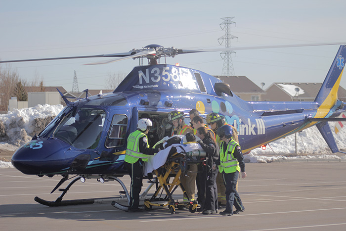 First responders put injured victim on helicopter