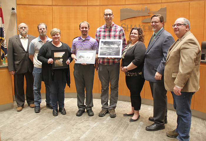 Photo contest winners with City Council members