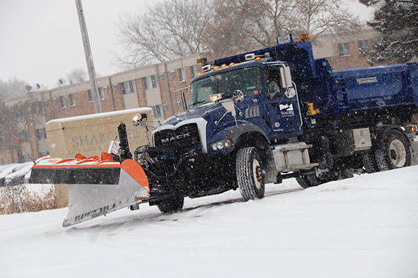 Snowplow in city hall parking lot