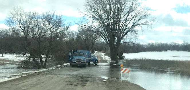Water flooding over gravel road