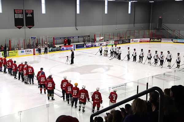 Hockey players line up before the game
