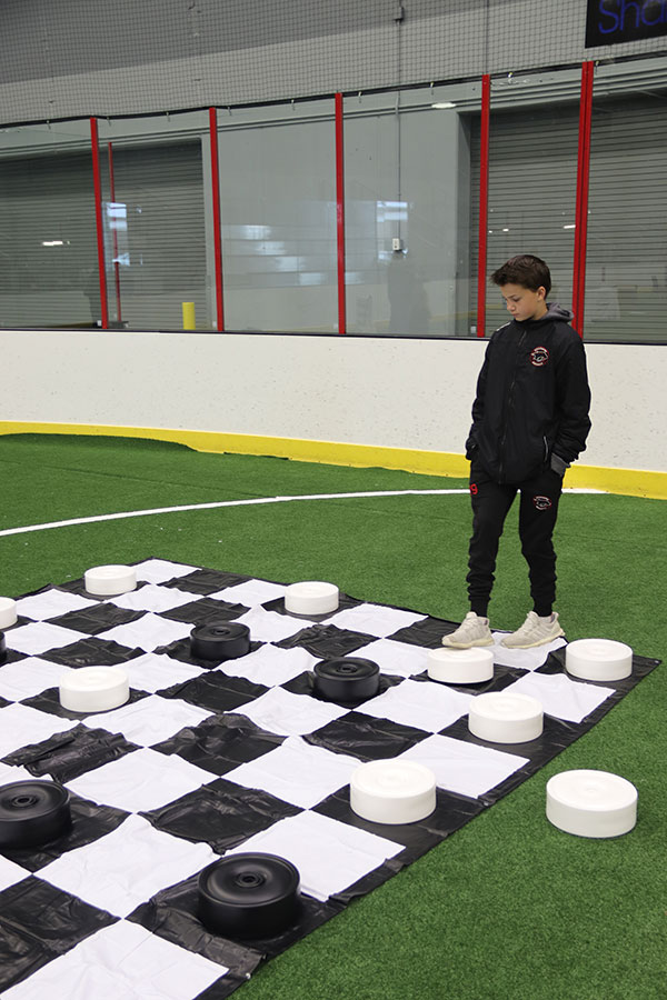 Boy playing on giant checkerboard