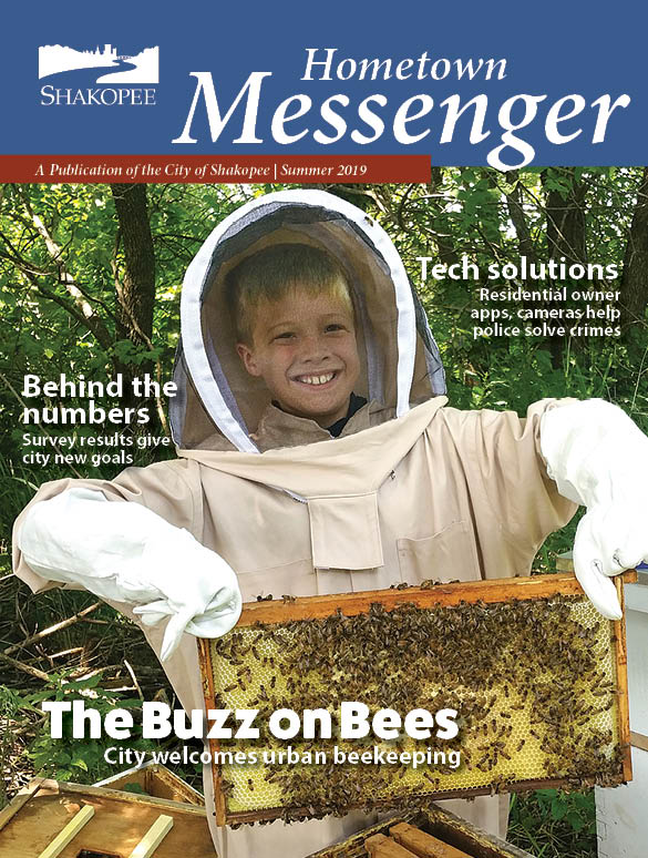 Cover of brochure with kid holding honeycomb
