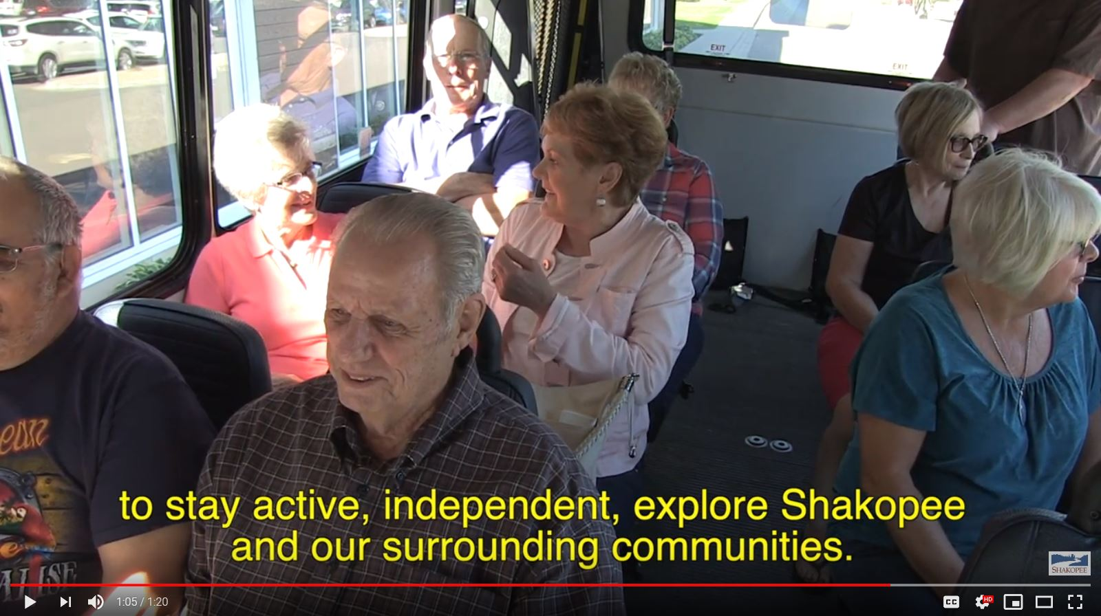 Seniors sitting on bus in video