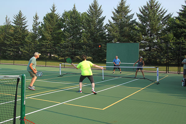people playing on pickleball courts