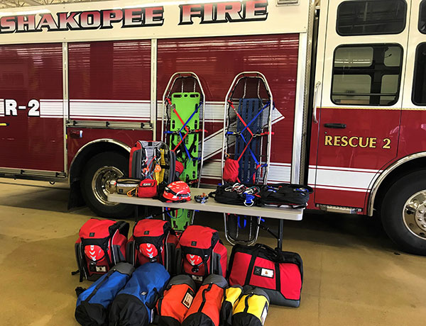 Equipment in bright bags in front of fire truck
