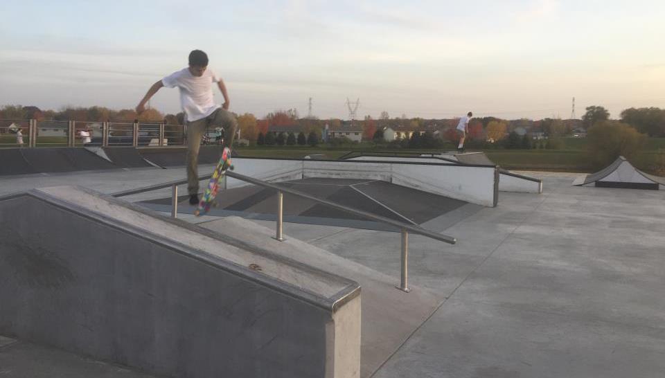 Teen skateboarding on ramp